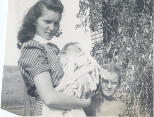 Patsy holding Elinda (w someone named Jean)