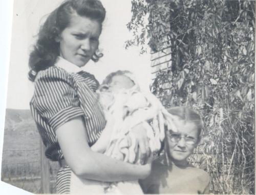 Patsy holding Elinda (w someone named Jean)